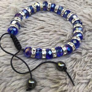 Blue crystal bracelet with red & purple undertones